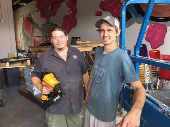 Biscuit Head co-owner, Jason Roy, left and kitchen manager, Mike Fisera, hard at work on the new restaurant in Greenville.