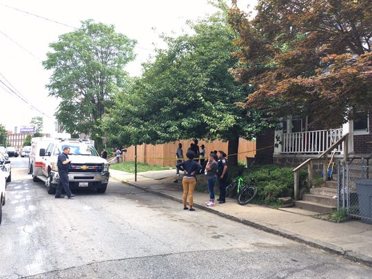 Emergency crews at a scene of a reported stabbing along West 26th Street in Wilmington.