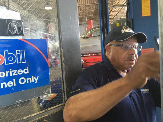 """Theodore """"Johnny"""" Jones looks at a work order on Tuesday at the Salisbury location of Delaware Tire Centers. Jones has worked there for 57 years."""