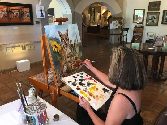 Sonoran Arts League artist Joye DeGoede paints at the Gallery at el Pedregal. DeGoede is one of the volunteer artists in residence.