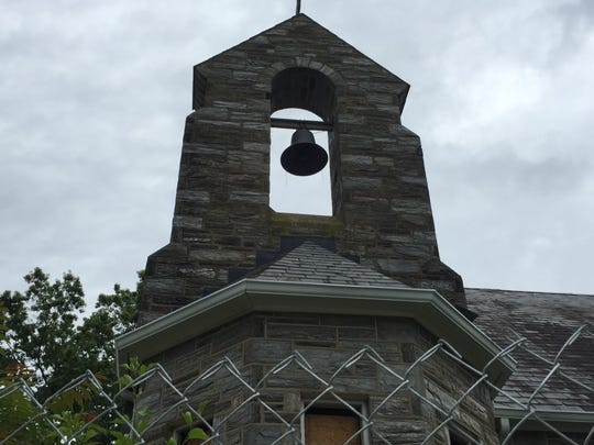 A long-silent bell rises over the former St. Gregory's Church in Magnolia.
