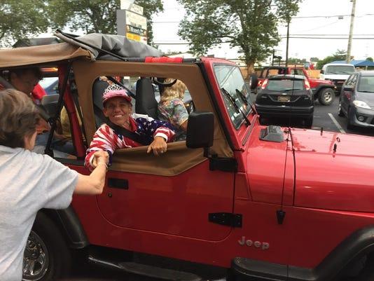 Cheryl Blackman rides in Jeep