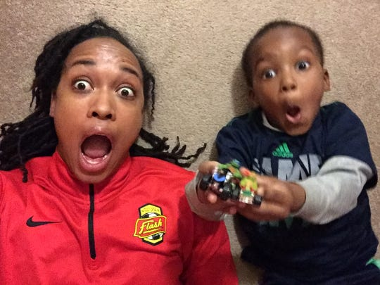 WNY Flash forward Jess McDonald and her son, Jeremiah, 4, pose for a funny shot. McDonald, 28, is the first 'Soccer Mom,' to ever suit up for the Flash.