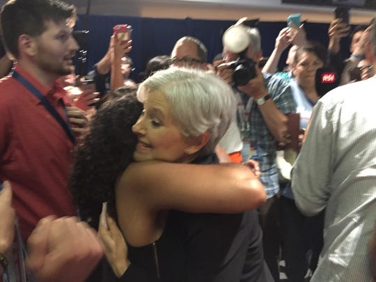 Green Party presidential candidate Jill Stein is hugged by a Bernie Sanders supporter at the Democratic National Convention in Philadelphia Tuesday.