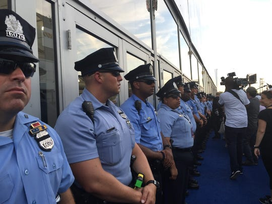 Philadelphia Police seal off a media tent after protesters entered it during a walkout at the Democratic National Convention Tuesday.