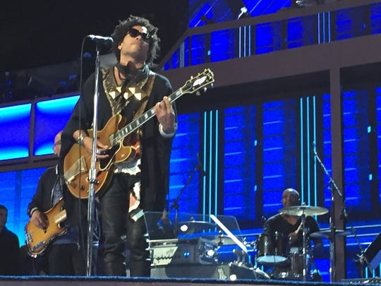 Lenny Kravitz and his band rehearse for a small crowd at the Democratic National Convention Wednesday morning.