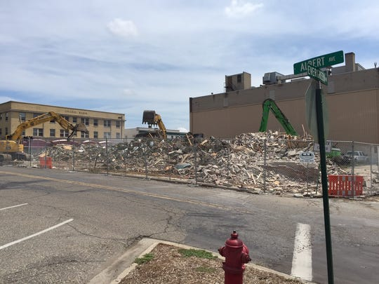 A former bank building in East Lansing at 303 Abbot Road was demolished July 28, 2016. The building was vacant for several years prior to its demolition.