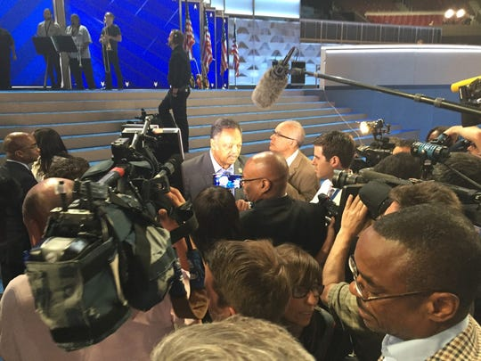 Reporters gather around civil rights leader Jesse Jackson Sr. at the Democratic National Convention in Philadelphia.