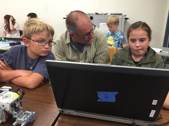 Students learn from a mentor about STEM education at New Mexico State University-Alamogordo. The campus hosted a two week camp.