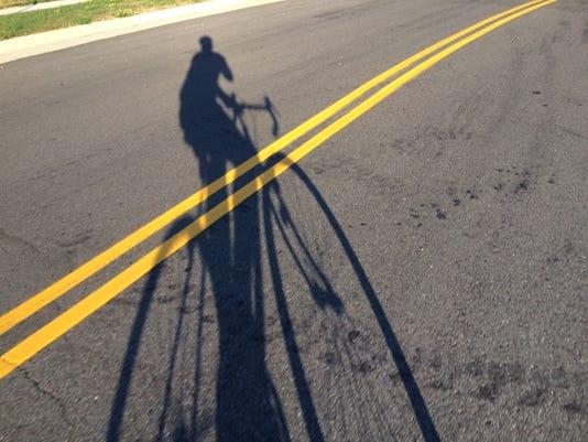 636057536047301194-Cycling-shadow.JPG