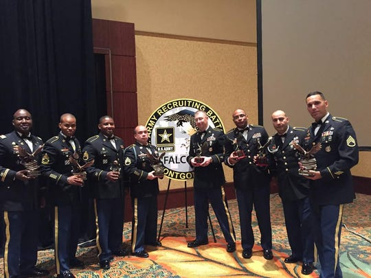 Army officers with Montgomery's Army Recruiting Battalion pose for an award ceremony.