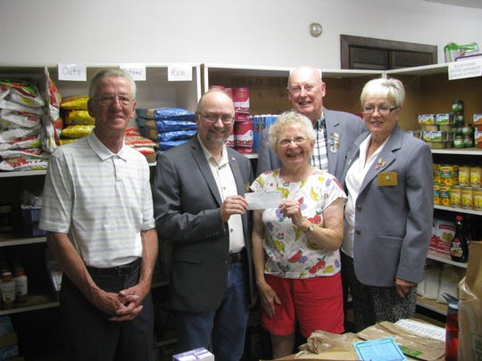 Left to right, Ed Sneddon (Elks Trustee), Alan Danielson (Elks Exalted Ruler), Gary Carlson (Lodge Secretary) and Rita Carlson ( Loyal Knight) present a check to Joan Barber, center, from the Food Pantry.