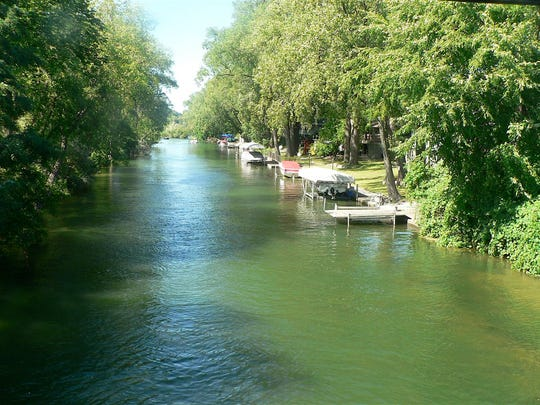 The Yahara River in Madison serves as the backyard for many houses and is a boaters delight.