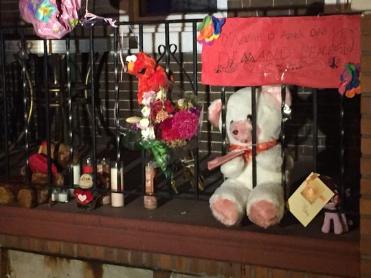 A memorial rises outside the South 8th Street home of an 8-year-old Camden girl who was shot in the head Wednesday. A family member said the child died Friday.