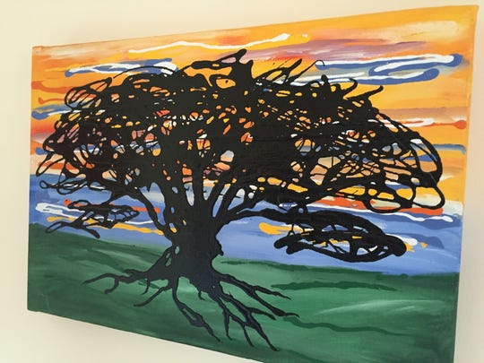 This piece by Derrick Ashworth is part of his live tree series of work.