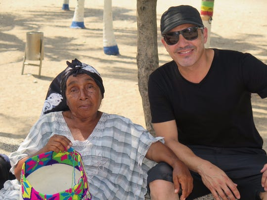 Diego Verney, right, was born and raised in Colombia, but returned earlier this month from La Guajira Desert with girlfriend Thea Mason to purchase the Wayuu tribeswomen's handcrafted bags.