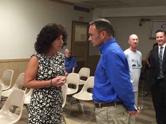 Lebanon Mayor Sherry Capello chats with Joe Morales Monday night after he was appointed to fill a vacancy on Lebanon City Council.