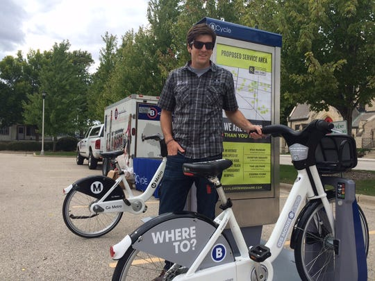 Will Rosenheimer, business development representative with BCycle, a company that produces bike share systems. The company demonstrated its product for a crowd of people in Fond du Lac's Hamilton Park Monday.