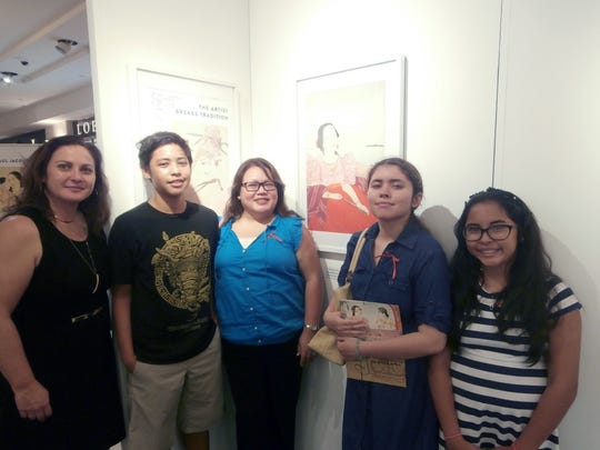 Descendants of Conception Guerrero Ð the Chamorro Woman in Red Ð include businessman Herman Guerrero (familian PŒn) and were represented at the exhibit by fourth-generation cousins.