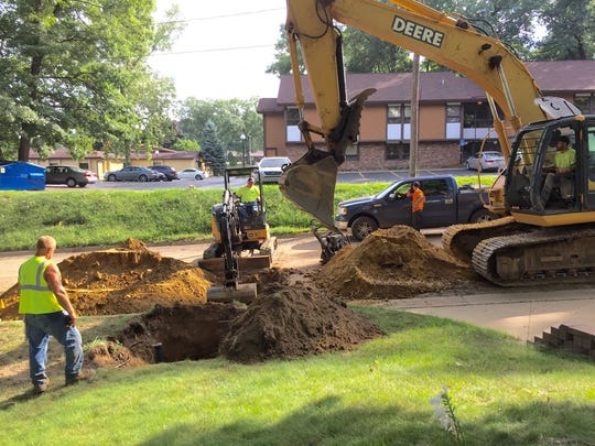 Crews work outside of Randy Vallance's South Shore Drive home in Emmett Township to allow connections to city of Battle Creek water after it was discovered the area had unsafe levels of arsenic entering water wells.