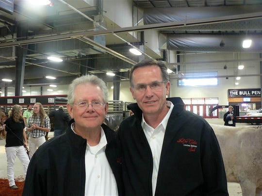 The sale was co-hosted by Mike Hellenbrand of City Slickers Farm (left) and Dan Basse, Guernsey Grove Farms.