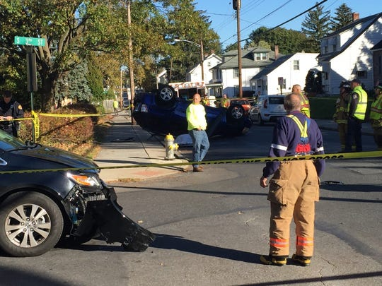 City fire crews and fire police work at the scene of a fatal crash at Pershing Avenue and Third Street Friday afternoon.
