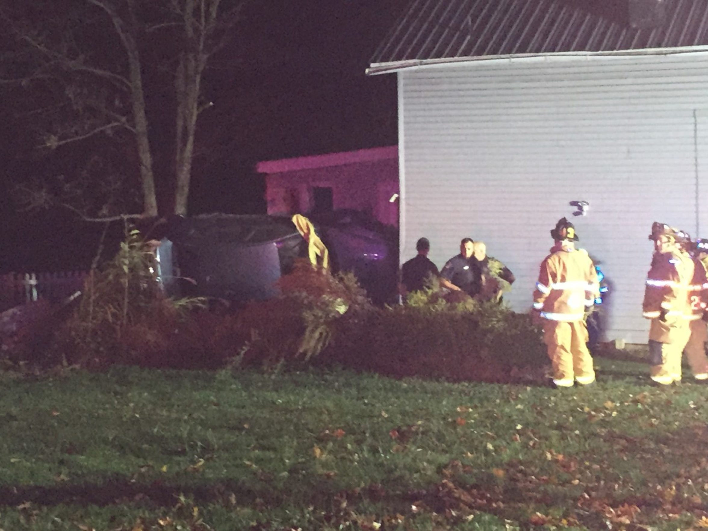 North Lebanon Township police and firefighters gather near a car that crashed into a house at 1446 N. Seventh Street after a high speed chase in November 2016.