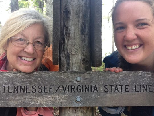 Jill Byrd, left, and one of her many hiking partners,