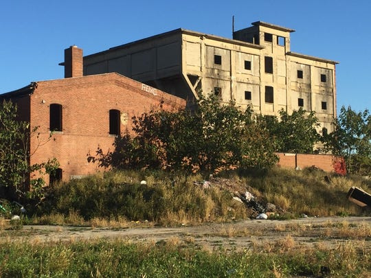 Camden's city council on Thursday will consider authorizing demolition of this five-story former industrial building that rises by Interstate 676 in the Bergen Square neighborhood.