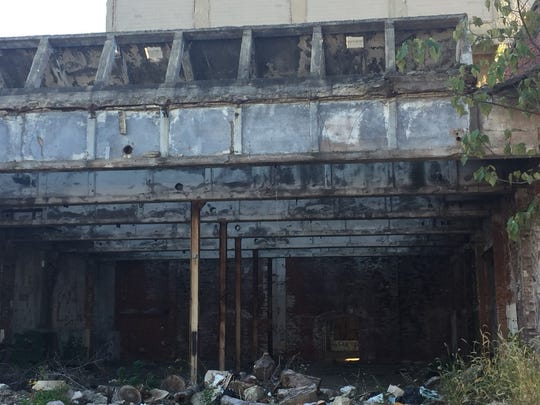 Homeless people are living inside a former industrial building that may face demolition in Camden's Bergen Square neighborhood.