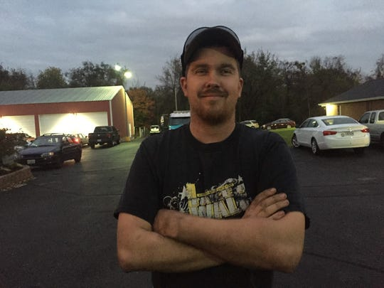 Timothy Oliger had waited for about an hour to vote on Election Day 2016.
