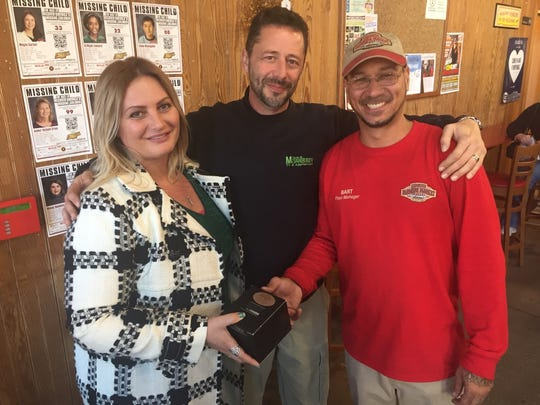 Joya and Tom Morrissey (from left) present a watch to Bart Rosado, who has been the floor manager of the Lebanon Farmers Market since it opened 10 years ago.