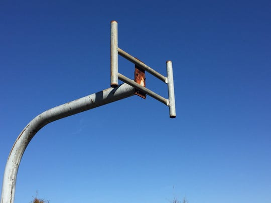 A backboard is missing on a basketball court at Rev. Evers Park in Camden.