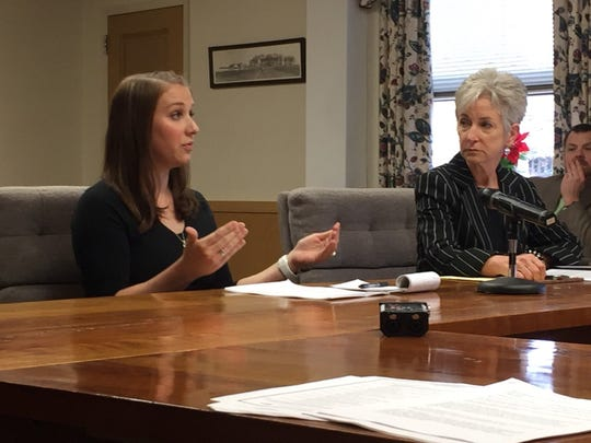 Ruthie Davis, president and COO of Pennsylvania Counseling Services, listens as Kim Ernest, vice president of criminal recovery services, discusses the new day reporting center with the Lebanon County commissioners on Thursday.