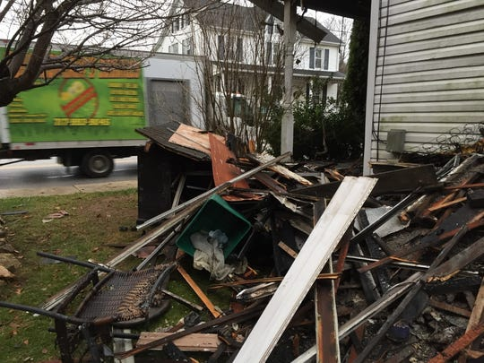 Debris is piled outside a home at 108 N. Constitution Ave. in New Freedom following a fire on Sunday night.