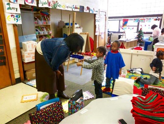 Principal Tiffany Watkins admires an ornament made
