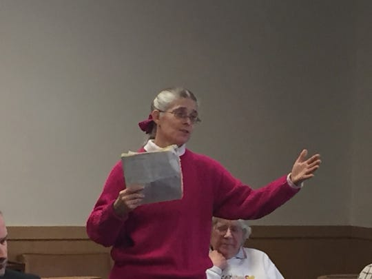Karen Simpson, who operates a dairy farm at Mil-ee Farms in North Lebanon Township explains to the county commissioners how limited access to a disputed farm lane will harm her business.