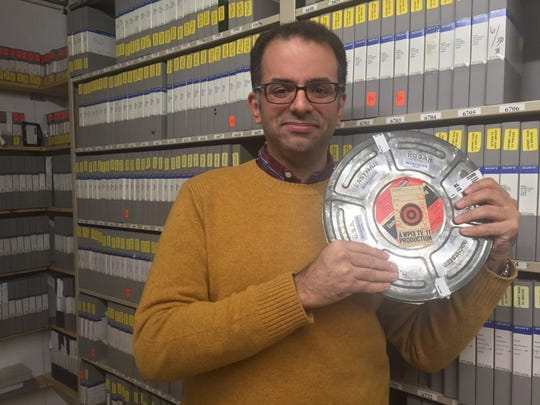 Rolando Pujol, director of digital and social strategy for PIX11 (and de facto archivist), with the film canister containing the much-sought 1966 footage of The Yule Log.