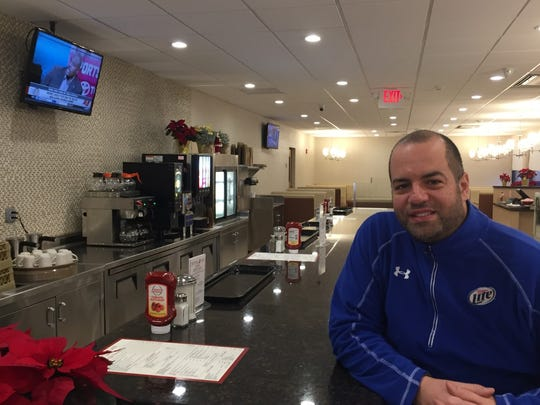 Tony Exadaktilos Jr. sits at the counter of his family's newly rebuilt Crystal Lake Diner.