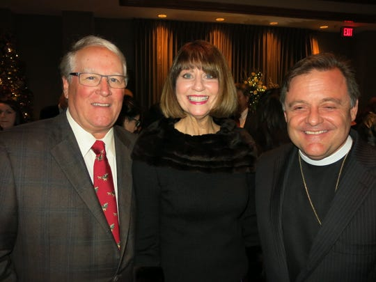 Stafford and Marianne Comegys and the Rev. Alston Johnson