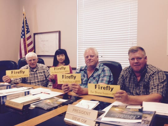Kayla Xu, second from left, with the Benton County Commissioners rallying for their support of Say's firefly as the state insect.