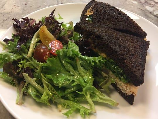 Special turkey sandwich on pumpernickel bread at Passerelle Bistro in Greenville.