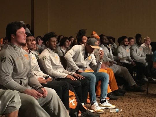 Members of the Tennessee football team watch a private wrestling event at  the Renaissance Nashville ballroom on Wednesday night.