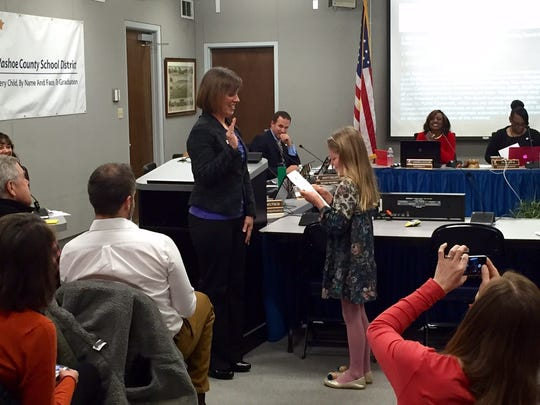 Malena Raymond, who now represents District D of the Washoe County School District, is sworn in by her daughter on Jan. 10, 2017.
