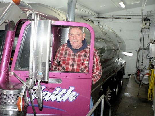 Bob Faith unloads his truck on his next to last day