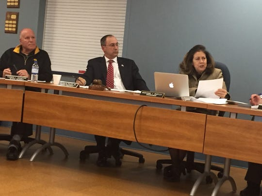 As Lebanon school board Vice-president Tom Schaffer (from left) and President Peter Pyles listen, Superintendent Marianne Bartley discusses the implications of property tax reform at a meeting held in January.