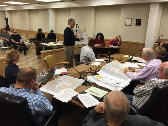 Thomas Englerth, a land surveyor for Site Development Concepts, explains the details of a proposed shopping center to the Lebanon Zoning Hearing Board on Wednesday.