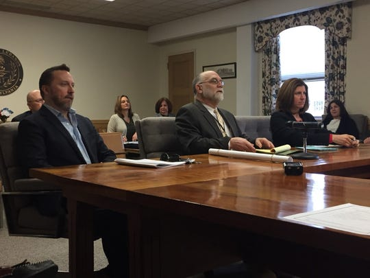 President Judge John C. Tylwalk (center), accompanied by Matt Barber, CEO of Office Services Company, and Chief Adult Probation Officer Sally Barry, discusses a plan to renovate the county's Adult Probation Office on Oak Street at Thursday's county commissioners' meeting.