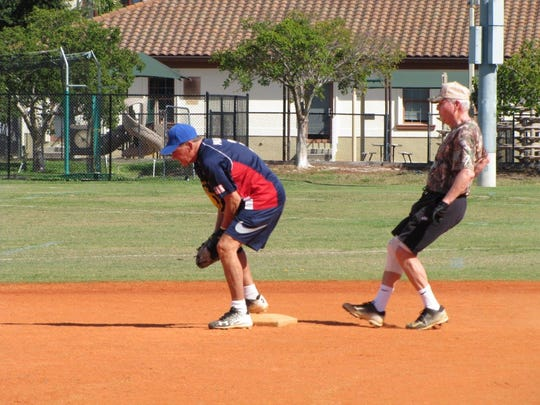 Raymond Malone of the American Legion Post gets the force out at second base on Jim O'Meara of the Moose Lodge.