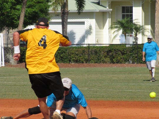 The Brewery's Bill Wright hustles into second as the ball gets based Nacho's Mama's Jeff Kaczka.